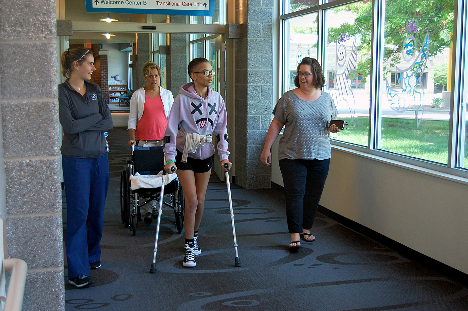 Sarah walking down the hallway.