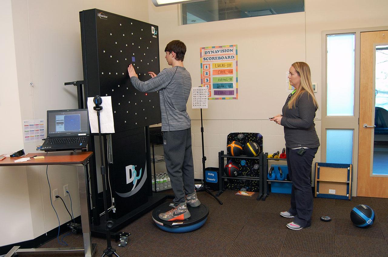Teen using the Dynavision reflex test