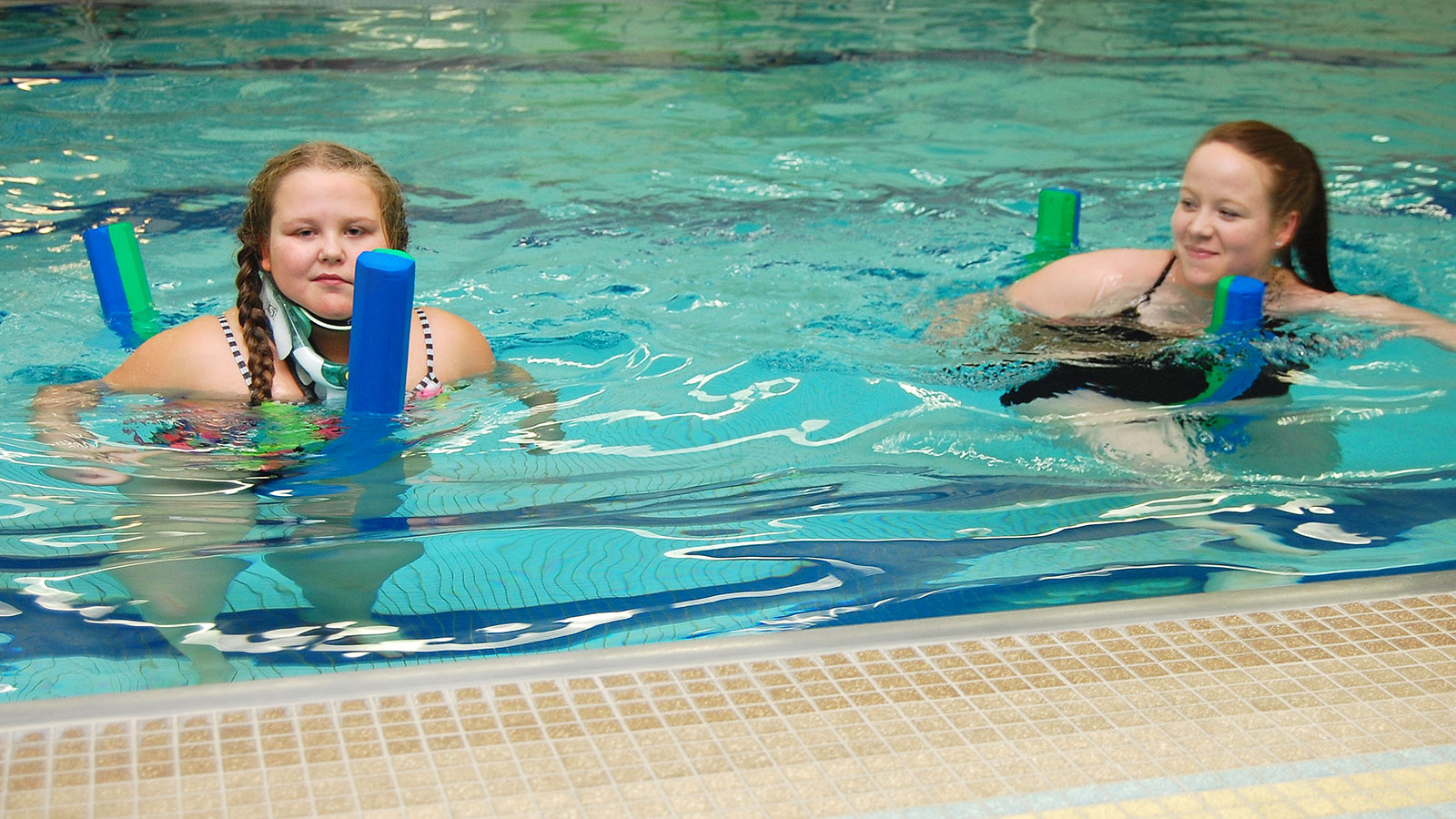 Gracen in the pool doing therapy