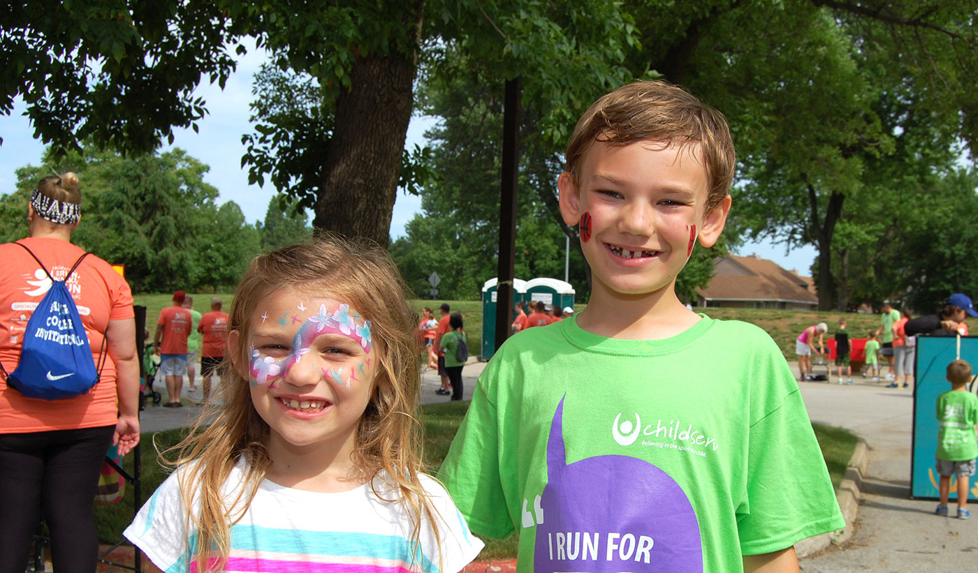 Smiling for the Camera at our Run Walk & Fun for the Kids fundraiser.