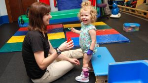 Child and Physical Therapist playing.
