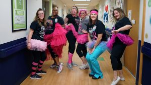 Staff from ChildServe's Transitional Care Unite are showing off their tutu's