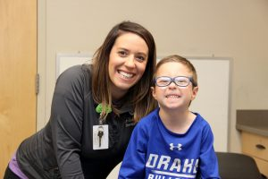 Bennett and Ashley, occupational therapist smiling.