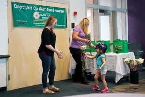 ChildServe staff and children interacting at the daisy award celebration