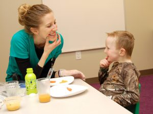 Brooke in feeding therapy with a little boy